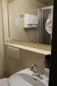 Ein Badezimmer in der Unterkunft Hotel Goldene Krone Innsbruck