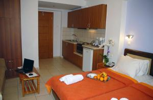 A kitchen or kitchenette at Aria Hotel Samos Town