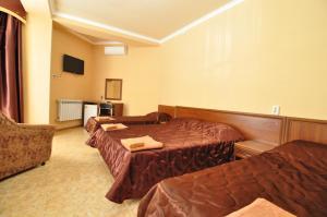 Кровать или кровати в номере Guest House Eliza