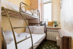 Двухъярусная кровать или двухъярусные кровати в номере Винтерфелл на Кропоткинской