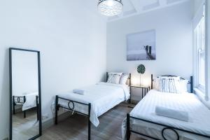 A bed or beds in a room at The Highberry - Sydney Harbour View Escape