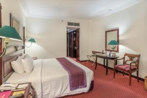 A bed or beds in a room at Inna Grand Bali Beach