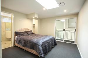 A bed or beds in a room at Design Sydney Home