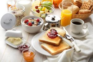 Breakfast options available to guests at Hotel Ilma