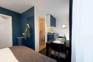 A bed or beds in a room at Stockholm Hotel Apartments Bromma