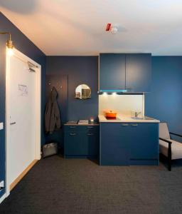 A kitchen or kitchenette at Stockholm Hotel Apartments Bromma