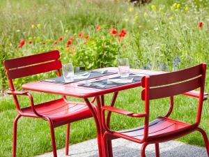 Restaurant ou autre lieu de restauration dans l'établissement Kyriad Lyon Est - Meyzieu ZI - Aéroport