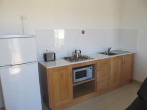 O bucătărie sau chicinetă la Shamrock Apartments