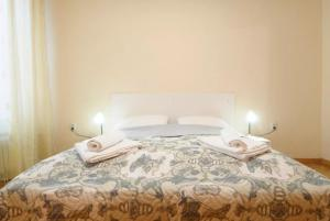 A bed or beds in a room at Urban Stay Apartment