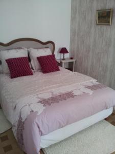 Un ou plusieurs lits dans un hébergement de l'établissement Le clos du château