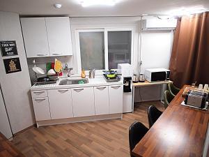 A kitchen or kitchenette at Hostel Gaon Sinchon