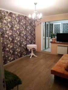 Телевизор и/или развлекательный центр в Apartment Simferopolskaya 22