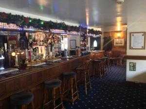 The lounge or bar area at The Jolly Huntsman