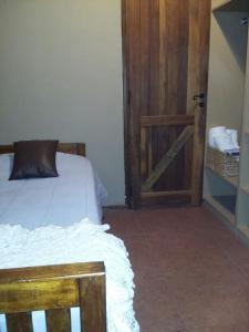 A bed or beds in a room at Casa de Vacaciones El Tata
