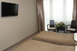 A television and/or entertainment center at Hotel Ikar
