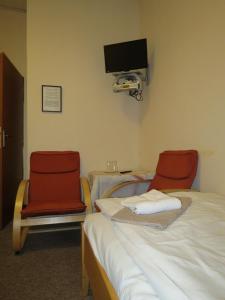 Postel nebo postele na pokoji v ubytování Hotel Český Dvůr