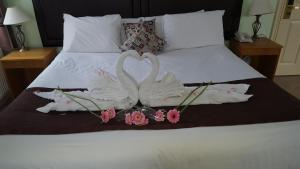 A bed or beds in a room at Castle Limes Hotel