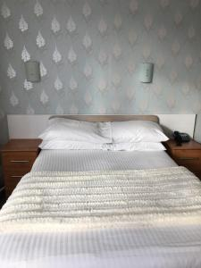 A bed or beds in a room at Durley Grange Hotel