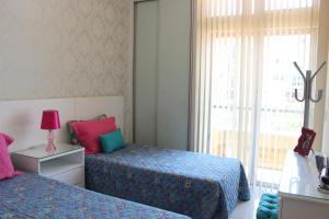 A bed or beds in a room at Maravilhoso apto na Praia do Forte
