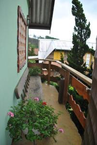 Uma varanda ou terraço em Hostel da Montanha