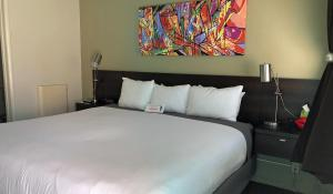 A bed or beds in a room at Bayfront Inn