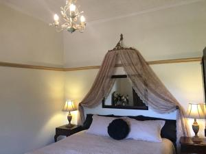 A bed or beds in a room at Rostrata Country House