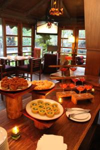 A restaurant or other place to eat at Gardenia Resort and Spa