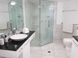 Ein Badezimmer in der Unterkunft Excellsior Apartments