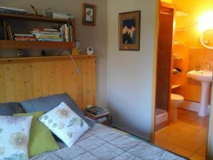 Un ou plusieurs lits dans un hébergement de l'établissement Chambre d'hôte Romarica