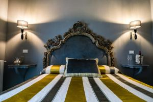 A bed or beds in a room at Il Covo B&B