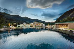 The swimming pool at or near Hotel Norica - Thermenhotels Gastein