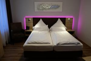 A bed or beds in a room at Minx – CityHotels