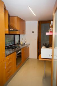 A kitchen or kitchenette at Civitá Design & Accommodation