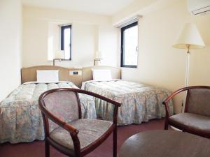 호텔 파크 애비뉴 객실 침대