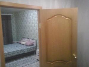 Кровать или кровати в номере 1-комнатная квартира ул. им. Есенина, 110/1