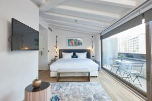 A bed or beds in a room at Manna Boutique Hotels
