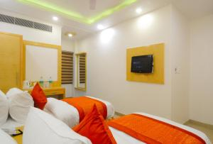 A bed or beds in a room at The Gold Inn Paharganj