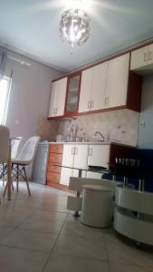 A kitchen or kitchenette at Amazing Apartment In The Center
