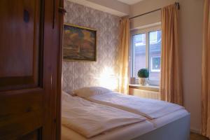 Ein Bett oder Betten in einem Zimmer der Unterkunft Hotel Restaurant Anno 1617