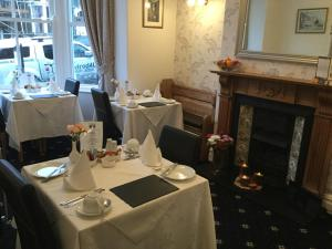 A restaurant or other place to eat at Dunsford Guest House