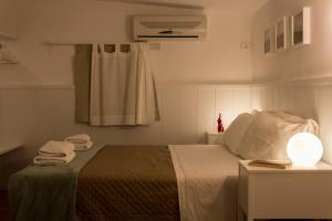 Letto o letti in una camera di Sui Tetti di Napoli