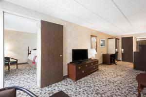 A television and/or entertainment center at Ramada Plaza by Wyndham Portland