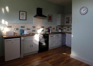 A kitchen or kitchenette at Meynell Mews