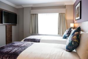 A bed or beds in a room at Innkeeper's Lodge Birmingham - NEC , Coleshill