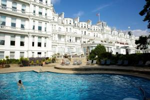 The swimming pool at or close to The Grand Hotel
