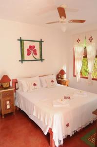 A bed or beds in a room at Pousada Pedra Menina