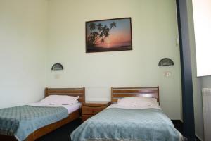Un pat sau paturi într-o cameră la Hotel Paradis