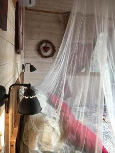 Un ou plusieurs lits dans un hébergement de l'établissement La cabane des amoureux