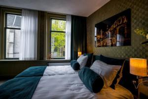 Een bed of bedden in een kamer bij Slapen bij hofman