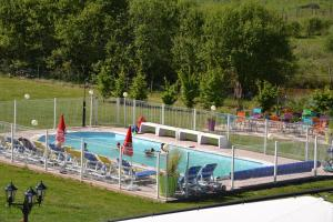 The swimming pool at or near Les Fruits du Passau